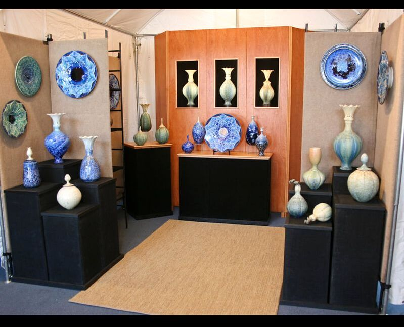 Vases and urns displayed on shelves